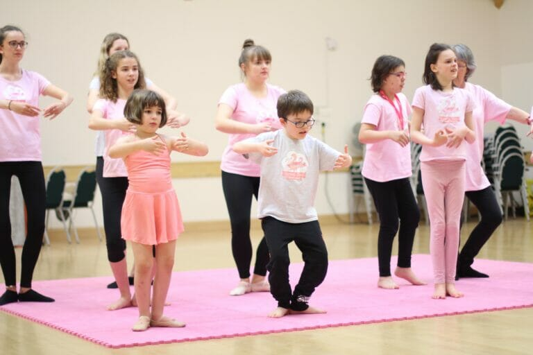 Flamingo Chicks class does plies in a ballet studio