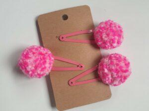 Three two-tone pink pom pom hairclips