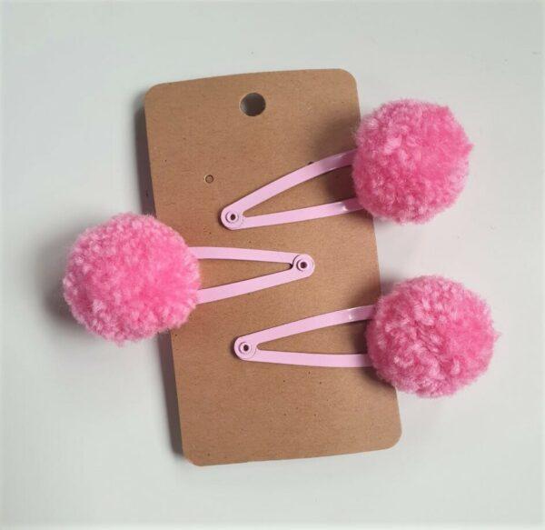 Pink pom pom hairclip