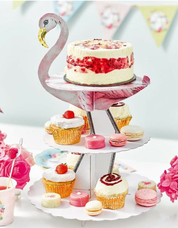 Cardboard flamingo cake stand with cupcakes places on it
