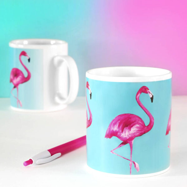 Ceramic mug with blue background and hot pink flamingo design on it