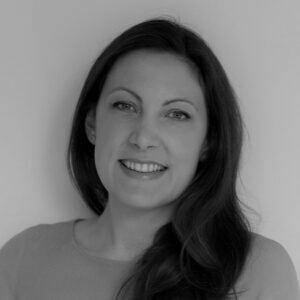 Black and white headshot of Katie Sparkes