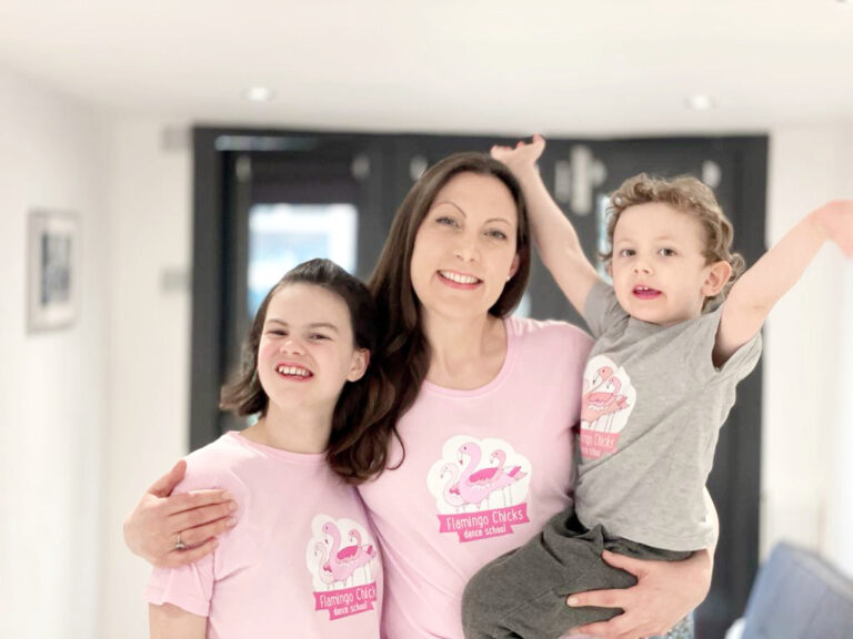 Katie Sparkes, Flamingo Chicks CEO poses with her son and daughter, all in Flamingo Chicks t-shirts