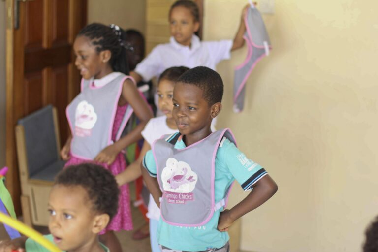 A young boy in a Flamingo Chicks tabard takes part in a dance class in Ghana