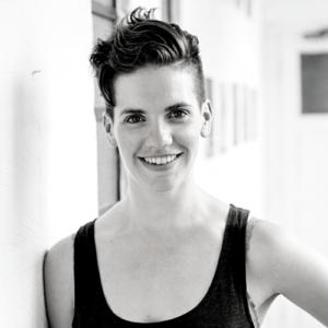 Rachel Sparks Dance teacher. Rachel has short hair and is smiling at the camera.